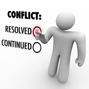 A man presses a button beside the word Resolved to resolve a con